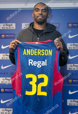 Us Forward Alan Anderson (28) Poses with the T-shirt of His New Team After Signing For Spanish Basketball Team Regal Barcelona in Barcelona North-eastern Spain 27 December 2010 Anderson Will Play with Barcelona Until the End of the Season to Substitute Injured Us Forward Pete Mickeal Spain Barcelona