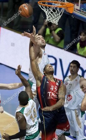 Tau Vitoria's Us Will Mcdonald (c) Jumps For the Rebound with Union Olimpija Ljubliana's Marko Milic (l) During Their Group C Euroleague Basketball Match Played at the Fernando Buesa Arena in Vitoria Spain on 10 December 2008 Spain Vitoria
