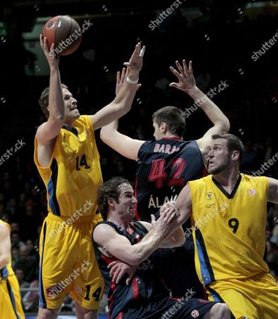 Maroussi's Player Levon Kendall (l) and Jared Homan (r) Try to Score in Presence of Argentinian Player Marcelino Huertas of Caja Laboral (c) During Their Euroleague Basketball Match at Buesa Arena in Vitoria Basque Country Northern Spain 06 January 2010 Spain Vitoria