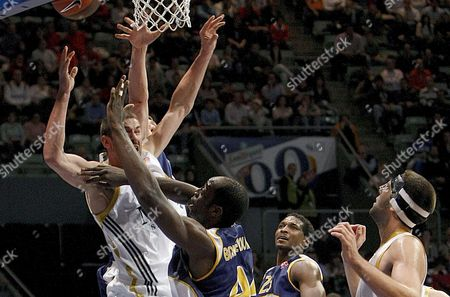 Real Madrid's Serbian Point Forward Marko Jaric (l) and Ewe Baskets Oldenburg's Cameroonian Center Ruben Boumtje Boumtje (2l) Fight For the Ball During Their Euroleague Basket Match Played at Palacio Vistalegre in Madrid Spain 6 January 2010 Spain Madrid