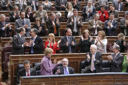 (l-r First Row) Spain's Prime Minister Jose Luis Rodriguez Zapatero Spanish Deputy Prime Minister Teresa Fernandez De La Vega Spanish Finance Minister Pedro Solbes Spanish Foreign Affairs Minister Miguel Angel Moratinos and Spain's Justice Minister Mariano Fernandez Bermejo Applaud After the Passing of the National Budget 2009 at the at the Congreso De Los Diputados (the Lower House in the Spanish Parliament) in Downtown Madrid Central Spain 18 December 2008 Spain Madrid