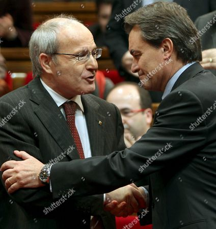 The New Nationalist Party (ciu) Prime Minister For the Spanish Region of Catalonia Artur Mas (r) is Congratulated by His Predecessor Former Socialist Premier Jose Montilla (l) Shortly After His Investiture in the Catalan Parliament in Barcelona Spain on 23 December 2010 Spain Barcelona