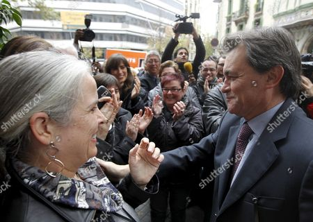 Artur Mas (r) Leader of the 'Convergencia i Unio' Party (ciu) Greets a Party Colleague As He Arrives As the Newly Elected Regional President of Catalonia at His Party's Headquarters in Barcelona Northeastern Spain on 29 November 2010 Embattled Spanish Prime Minister Jose Luis Rodriguez Zapatero's Socialist Party Suffered a Heavy Defeat 28 November in Elections in the Key North-east Region of Catalonia the Socialist Prime Minister of the Region Jose Montilla Lost to Artur Mas Leader of the Catalan Nationalist Party Ciu Which Had Governed Catalonia For 23 Years Until 2003 Spain Barcelona