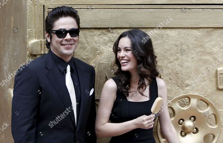 Puerto Rican Actor Benicio Del Toro Poses with Brazilian Actress Caroline Correa at Their Arrival to a Famous Restaurant in Barcelona Norteastern Spain 08 April 2010 Del Toro Has Shot an Advertisement where He Plays the Role of an Ice-cream Thief For a Well-known Brand Spain Barcelona