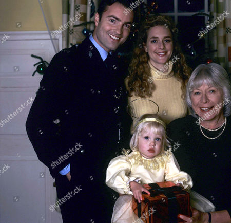 'Heartbeat' - Series 6 - Episode 17 - 'Charity Begins At Home' -  PC Nick Rowan [Nick Berry], Jo [Juliette Gruber], Katie [Emily/Amelia Dingley] and Eileen [Anne Stallybrass]