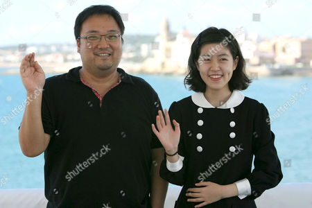 Stock Image of Korean Film Director Yim Pil-sung (l) and the Actress Shim Eun-kyung Pose For the Photographers After Presenting the Film 'Hansel & Gretel' in the International Film Festival of Sitges Near Barcelona Spain 06 October 2008 Spain Sitges