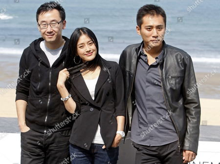 Chinese Director Lu Chan (l) and Actors Liu Ye (r) and Qin Lan (c) Pose For Photographers During the Presentation of Their Film 'City of Life and Death' at the San Sebastian International Film Festival in San Sebastian Northern Spain 21 September 2009 Spain San Sebastian