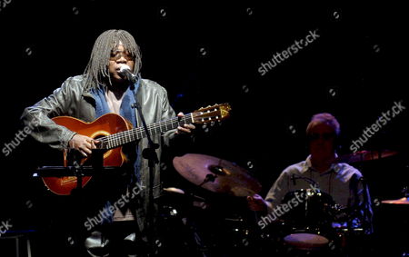 Brazilian Singer Milton Nascimento (l) Performs at Coliseum of a Coruna Galicia Spain 25 April 2008 to Launch His New Spectacle 'Novas Bossas' Based in Traditional Brazilian Music Specially From a Brazilian Legendary Singer Antonio Carlos 'Tom Jobim' Drums Player (r) is Paulo Braga who Used to Play with Tom Jobim in His Concerts Spain a Coruna