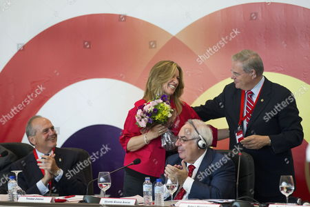 Spanish' Foreign Affairs Minister Trinidad Jimenez (second From Left)) Receives a Posy of Flowers From Us Senator From New Jersey Robert Menendez (r) After Singing Her 'Happy Birthday' in the Presence of Principado Asturias' Regional President Vicente Alvarez Areces (2r) and Spain-eeuu Council Foundation Juan Rodriguez Inciarte (l) on the Ocassion of the 16? Spain-eeuu Forum Held in Ovierdo Asturias Northern Spain 04 June 2011 Spain Oviedo