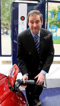 Barcelona Mayor Jordi Hereu Uses the Charger Following the Inauguration of Spain's First Fast-charge Point For Electric Cars on 14 April 2011 at a Petrol Station in Barcelona the Charger Has Been Installed by Spanish Oil Company Cepsa and Spanish Energy Giant Endesa Spain Barcelona