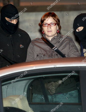 Stock Image of Former Basque Nationalist Party Pctv-ehak Treasurer Sonia Jacinto is Escorted by Police Officers After a Research at Basque Country Nationalist Trade Union Lab ('euskal Herriko Langile Abertzaleen Sindikatua' in Basque Language) Headquarters in San Sebastian Basque Country Northern Spain 13 October 2009 Four Lab's Members and Former Speaker of Illegal Batasuna Party Arnaldo Otegi Were Arrested at Lab's Headquarters in an Operation to Avoid the Reconstruction of the 'National Board' of Batasuna Party the Operation was Ordered by Spanish Audiencia Nacional Court Judge Baltasar Garzon Spain San Sebastißn