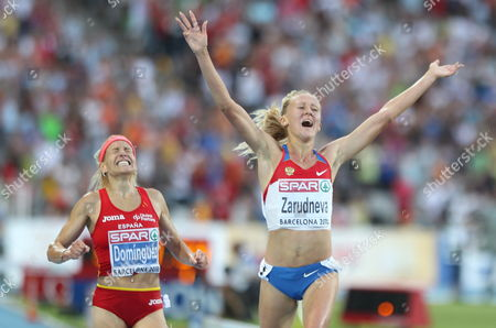 Stock Picture of Spanish Athlete Marta Dominguez (l) and Russian Yuliya Zarudneva (r) During 3000 Meter Women's Steeplechase Final in the European Athletics Championships Barcelona 2010 Held at the Olympic Stadium Lluis Companys in Barcelona North-eastern Spain 30 July 2010 Zarudneva Won the Medal Gold Spanish Martha Dominguez Won Silver and Russian Lyubov Kharlamova Won the Bronze Medal Spain Barcelona