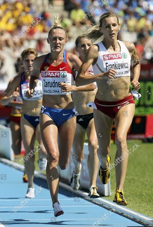 Stock Photo of Russian Athlete Yuliya Zarudneva (l) and Polish Wioletta Frankiewicz (r) Take Part in Women's 3000 Metres Steeplechase Qualifying Round at European Athletics Championships on 28 July 2010 at Lluis Companys Olympic Stadium in Barcelona Northeastern Spain Spain Barcelona