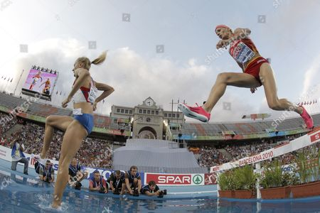 Stock Photo of Russian Athlete Yuliya Zarudneva (l) and Spanish Marta Dominguez (r) Compete in the Women's 3 000 Metres Steeplechase Final During the European Athletics Championships Barcelona 2010 at the Olympic Stadium Lluis Companys Barcelona North-eastern Spain 30 July 2010 Zarudneva Won the Gold and Dominguez the Silver Medal Spain Barcelona
