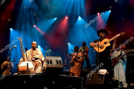 Mali Musician Toumani Diabate (l) and Cuban Singer Eliades Ochoa (r) Perform During His Concert at Expo Zaragoza Theatre in Zaragoza Northern Spain on 10 August 2008 Spain Zaragoza
