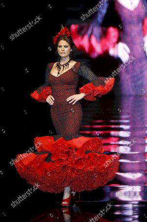 Spanish Model Maria Jose Suarez Takes to the Catwalk Wearing a Design of Collection 'Dreams' by Spanish Designer Lina During the Last Day of the 17th Flamenco Fashion Show Simof-2011 at the Palace of Congress in Seville Southern Spain on 06 February 2011 Spain Sevilla