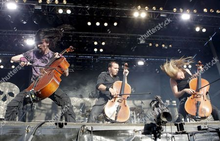 Finnish Heavy Band 'Apocalyptica' Members Perttu Kivilaakso (l) Paavo Loetjoenen (c) and Eicca Toppinen Perform on Stage During Their Concert at Metalway Festival in Zaragoza Aragon Spain 26 June 2009 Spain Zaragoza