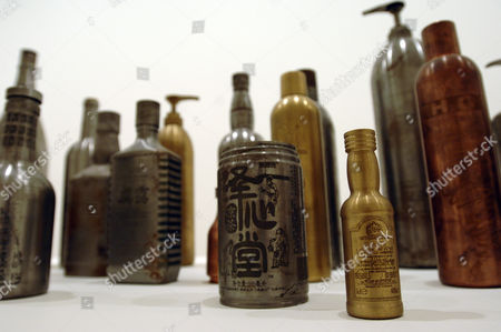 """""""Year Two Thousand , Another Two Thousand Years To Rust' 1999- 2006 set of 23 hand made and etched life size wine and beer bottles by Zheng Guogu here transient icons of commodity culture are made indestructible aniti-ergonomic bollards."""