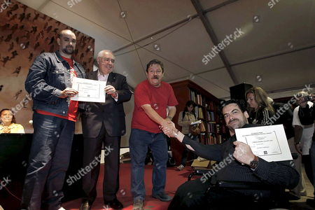 Argentina's Leonardo Oyola (l) and Spain's Juan Ramon Biedma (r) Co-recipients of the Dashiell Hammett Crime Fiction Prize Pose with the President of the Principality of Asturias Vicente Alvarez Areces (2-l) and the Organizer of the Semana Negra Paco Ignacio Taibo Ii (2-r) During the Closing Ceremony of the 21st Annual Semana Negra ('black Week') Literary Festival Held in Poniente Beach in Gijon Spain 20 July 2008 Oyola and Biedma Were Honoured by the International Association of Crime Writers For 'Chamame' and 'El Iman Y La Brujula' Respectively Spain Gijon