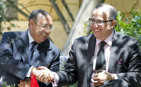 Moroccan Foreign Affairs and Cooperation Minister Taib Fassi-fihri (r) Congratulates Moroccan Diplomat Youssef Amrani (l) During the Inauguration Ceremony of Amrani As New General Secretary of the Union For the Mediterranean at Palau De Pedralbes in Barcelona Northeastern Spain on 05 July 2011 Spain Barcelona