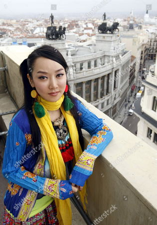 Stock Image of Chinese Folk Singer Sa Dingding Poses During an Interview with Efe News Agency to Talk About Her Latest Album 'Harmony' in Madrid Spain 05 March 2010 Dingding is on a Promotional Tour of Her Album Which Will Take Her to Zuerich Next Spain Madrid