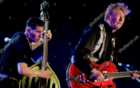 Us Band Stray Cats Guitarist and Singer Brian Setzer (r) and Bassist Lee Rocker (l) Perform on Stage During Their Concert at Expo 2008 Amphitheater 43 in Zaragoza Northeasthern Spain 17 August 2008 Spain Zaragoza