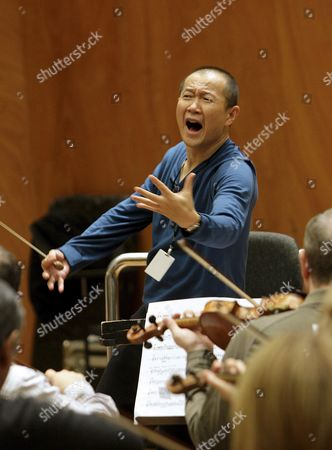 The Chinese Contemporary Classical Composer Tan Dun a Long-time Collaborator with Film Maker Yang Zhimou and Composer of the Music For the Medal Ceremonies at the Beijing 2008 Olympics Conducts a Rehearsal with the Bilbao Symphony Orchestra on 17 November 2009 at Bilbao Spain's Palacio Euskalduna where He Will Offer a Concert on 19 November 2009 Spain Bilbao