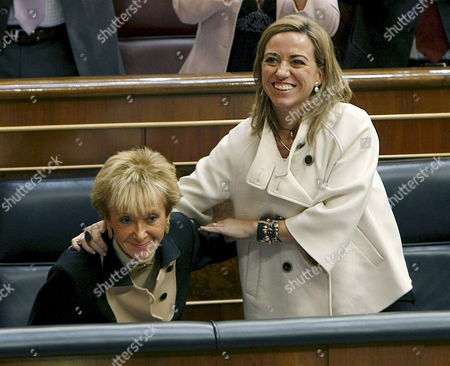 Spanish Defense Minister Carmen Chacon (r) Congratulates Spain's First Deputy Prime Minister Maria Teresa Fernandez De La Vega (l) who Addressed the Parliament During the Weekly Parliamentary Session in Madrid Spain on 25 November 2009 Fernandez De La Vega Explained the Moves Made by the Spanish Government to Secure the Release of Fishers of the Spanish Tuna Ship 'Alakrana' Which was Kidnapped by Somalian Pirates Spain Madrid