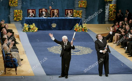Us Engineers Raymond Samuel (r) and Martin Cooper Acknowledge the Audience After Receiving the Prince of Asturias Award For Scientific and Technical Research at the Campoamor Theatre in Oviedo Northern Spain 23 October 2009 Spain Oviedo