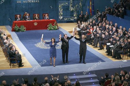 Stock Image of The Winners of the Prince of Asturias Award For Technical and Scientific Research (l-r) Us Biochemists Linda Watkins and David Julius and Israeli Geneticist Baruch Minke Aknowledge the Audience's Applause During the 2010 Prince of Asturias Awards Ceremony at the Campoamor Theater in Oviedo Spain 22 October 2010 Spain Oviedo
