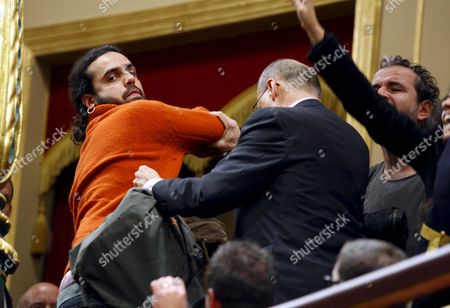 Spanish Actor Willy Toledo (r) and Other Demostrators Are Expelled From the Guest's Platform of the Lower House in the Spanish Parliament After They Started to Shout Slogans to Support the Saharan People in Madrid Spain 02 December 2010 Spain Madrid