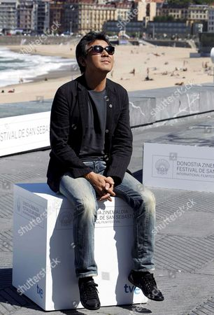 South Korean Film Director Ji-woon Kim Poses For a Photograph After the Photocall For the Movie 'I Saw the Devil' at the 58th Annual San Sebastian Film Festival in San Sebastian Spain 18 September 2010 the Movie is Presented in the Official Selection of the Festival Running From 17 to 25 September 2010 Spain San Sebastian