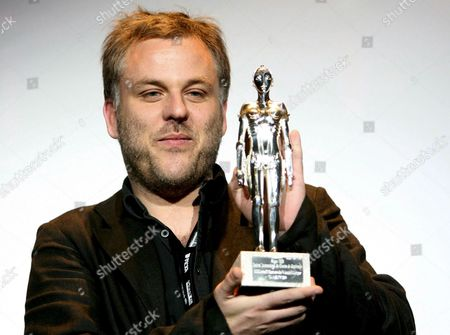 Stock Image of French Director Pascal Laugier Shows His Award For Best Make-up Effects in His Film 'Martyrs' in the Name of Bendit Lestang and Adrien Morot As He Poses For the Media During the Awards Ceremony of the Sitges Festival Film in Sitges Spain 11 October 2008 Spain Sitges
