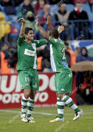 Real Betis' Midfielder Francisco Munoz 'Xisco' (l) Celebrates with His Teammate German Forward David Odonkor After Scoring Against Atletico Madrid During Their Spanish First Division League Soccer Match at Vicente Calderon Stadium in Madrid Spain 19 April 2008 Spain Madrid