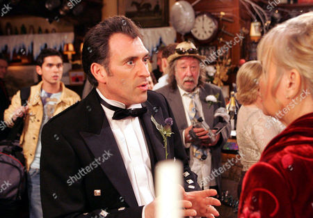 'Emmerdale'   TV   2006 Pictured: When Bob Hope (Tony Audenshaw) has a go at Jean Hope (Susan Penhaligon) about trying to ruin his wedding day, his son Jamie Hope (Alex Carter) turns up and thumps him. He in return gets punched by Scott. Also pictured Shadrach Dingle.