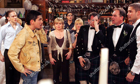 'Emmerdale'   TV   2006 Pictured: When Bob Hope (Tony Audenshaw) has a go at Jean Hope (Susan Penhaligon) about trying to ruin his wedding day, his son Jamie Hope (Alex Carter) turns up and thumps him. He in return gets punched by Scott Windsor (Ben freeman). Also pictured Josh Hope (Marc Silcock), Barbara Hope (Julie Dawn Cole), Paul Lambert (Matthew Bose), Nicola Blackstock (Nicola Wheeler) and Terry Woods (Billy Hartman).