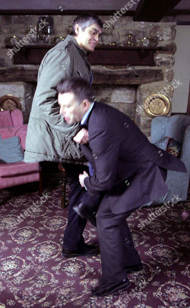 'Emmerdale'   TV   2006 Pictured: Terrence Turner (Nick Brimble) turns up to theaten Adam Forythe (Richard Shelton) but things quickly turn aggresive.  When Adam renders Terrence unconcious he panics and wonders what to do next.