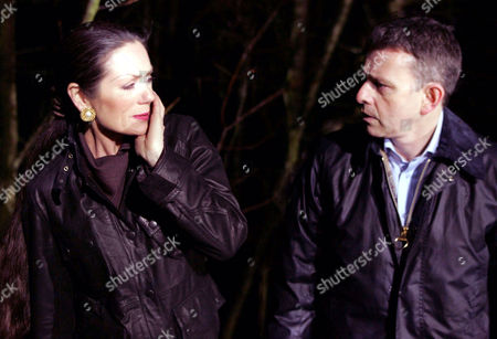 'Emmerdale'   TV   2006 Pictured: Steph Stokes (Lorraine Chase) and Adam Forsythe (Richard Shelton) bury Terrences body but when Steph panics, Adam slaps her and she's scared she's seen a different side to him.