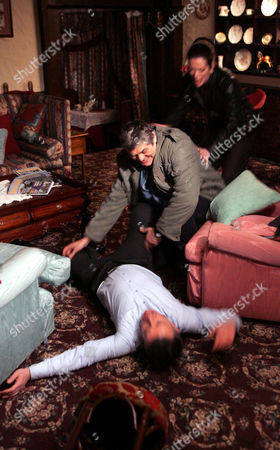 'Emmerdale'   TV   2006 Pictured: Terrence Turner (Nick Brimble) attacks Adam and Steph and in the struggle Adam knocks him down the stairs. Is it the end of Terrence?