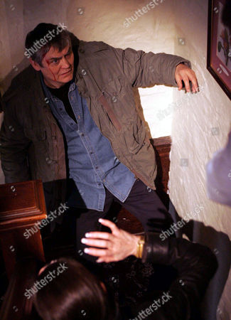 'Emmerdale'   TV   2006 Pictured: Terrence Turner (Nick Brimble) attacks Adam Forsythe (Richard Shelton) and Steph Stokes (Lorraine Chase) and in the struggle Adam knocks him down the stairs. Is it the end of Terrence?