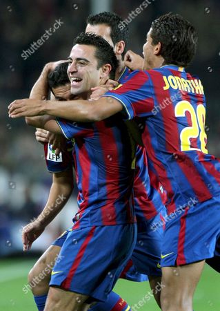 Fc Barcelona's Forward Pedro Eliezer (l) Celebrates with His Team Mates Xavi Hernandez (c) Sergi Busquets (top) and Brazilian Jonathan Dos Santos (r) After Scoring First Goal Against Villarreal During Their Spanish Primera Division Soccer Match at Camp Nou Stadium in Barcelona Northeastern Spain 02 January 2010 Spain Barcelona