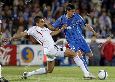 Getafe Cf's Striker Manu Del Moral (r) Tries to Shoot the Ball Against Brazilian Defender Lucimar Da Silva Ferreira 'Lucio' of Bayern Munich During Their Second Leg Uefa Cup Quarter Finals Soccer Match at Coliseum Alfonso Perez in Getafe Near Madrid Central Spain 10 April 2008 Spain Getafe
