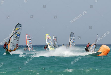 French Windsurfer Antoine Albeau (l) Us Windsurfer Kevin Pritchard (r) and Another Windsurfers in Action During the 2009 Gran Canaria Pwa Grand Slam on Sotavento Beach in Pajara Fuerteventura Canary Islands Spain 24 July 2009 Spain Pajara