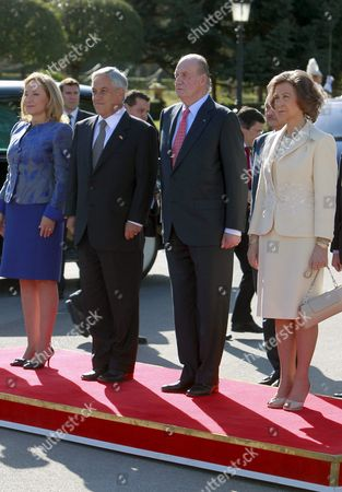 Spanish King Juan Carlos (2-r); His Wife Queen Sofia (r) Chilean President Sebastian Pinera (2-l) and His Wife Cecilia Morel De Pinera (l) Stand at Attention As the Two Countries' National Anthems Are Played Upon Their Arrival to the El Pardo Palace Outside Madrid Spain on 07 March 2011 the Chilean President Arrived in Spain on 07 March For a State Visit Aimed at Strengthening Political Economic and Cultural Ties Between the Two Spanish-speaking Nations Spain Madrid