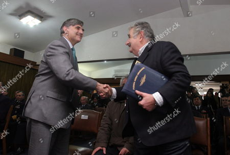 Uruguayan President Jos? Mujica (r) and General Director of the Defense Division of Indra Rafael Gallego (l) Shake Hands During the Delivery of Two New Three-dimensional (3d) Radars at the General Commando of the Uruguayan Air Force in Montevideo Uruguay 27 July 2010 the Spanish Company Indra Sistemas Delivered the Two Radars For with a Value of 25 Million Dollars Uruguay Montevideo