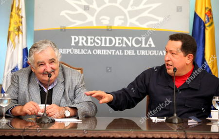 Uruguayan President Jos? Mujica (l) and His Venezuelan Counterpart Hugo Chßvez (r) Speak During a Press Conference at the Presidential Residence of Suarez in Montevideo Uruguay 30 March 2011 Uruguay Montevideo