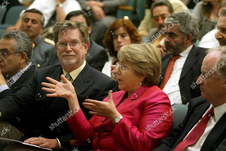 President of Chile Michelle Bachelet (c) Asks a Question From the Panel After a Lecture on Energy Efficiency Solar Energy and Biofuels at the Lawrence Berkeley National Laboratory in Berkeley California Usa 12 June 2008 George Smoot (l) University of Calfornia Berkeley Physics Professor and Winner of the 2006 Nobel Physics Prize and Chile Foreign Minister Alejandro Foxley (r) Sit Beside Her United States Berkeley