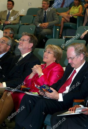 President of Chile Michelle Bachelet (c) Listens to a Lecture on Energy Efficiency Solar Energy and Biofuels with George Smoot (l) University of Calfornia Berkeley Physics Professor and Winner of the 2006 Nobel Physics Prize and Chile Foreign Minister Alejandro Foxley (r) at the Lawrence Berkeley National Laboratory in Berkeley California Usa 12 June 2008 United States Berkeley