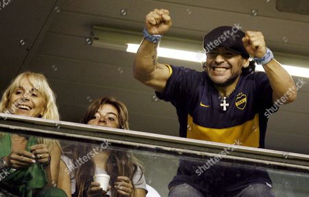 Former Argentinean Soccer Star Diego Armando Maradona (r) Supports His Team Boca Juniors Along with His Wife Claudia Villafane (l) and His Daughter Gianina (c) During Their Libertadores Cup Match Against Venezuela's Union Atletico Maracaibo at La Bombonera Stadium in Buenos Aires Argentina 22 April 2008 Boca Beat Maracaibo 3-0 Argentina Buenos Aires