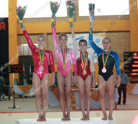 Stock Photo of From Left to Right Colombian Catalina Escobar Silver Medall Venezuelan Jessica Lopez Gold Medal Peruvian Britt Reusche and Colombian Rudy Marcela Sandoval with Bronze Medal Pose at the Podium After Their Rhythmic Gymnastics Competition at the Bolivarian Games Match in Sucre Bolivia 19 November 2009 Bolivia Sucre